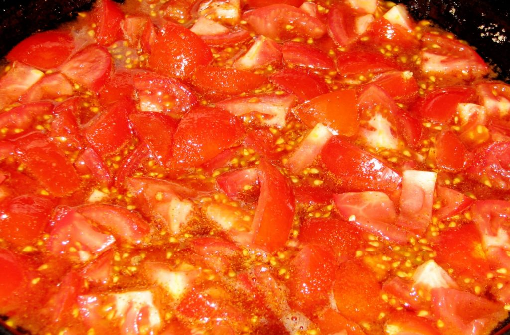 Simmer your tomatoes and spices.