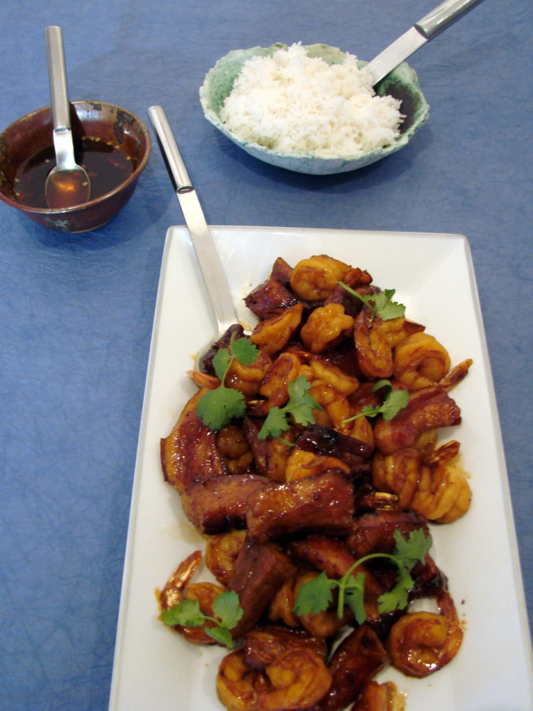 Serve this dish with the sauce and rice.