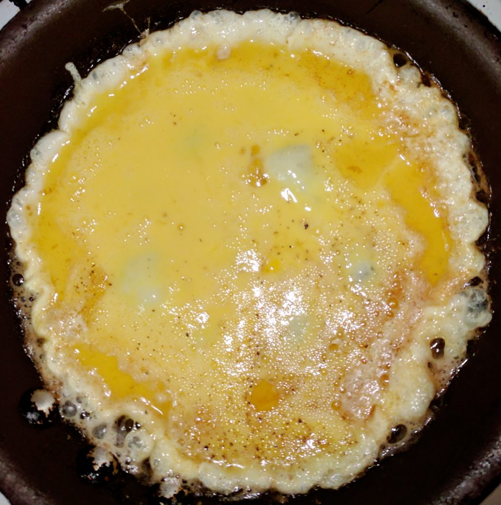 First pour your egg-mixture into the pan.