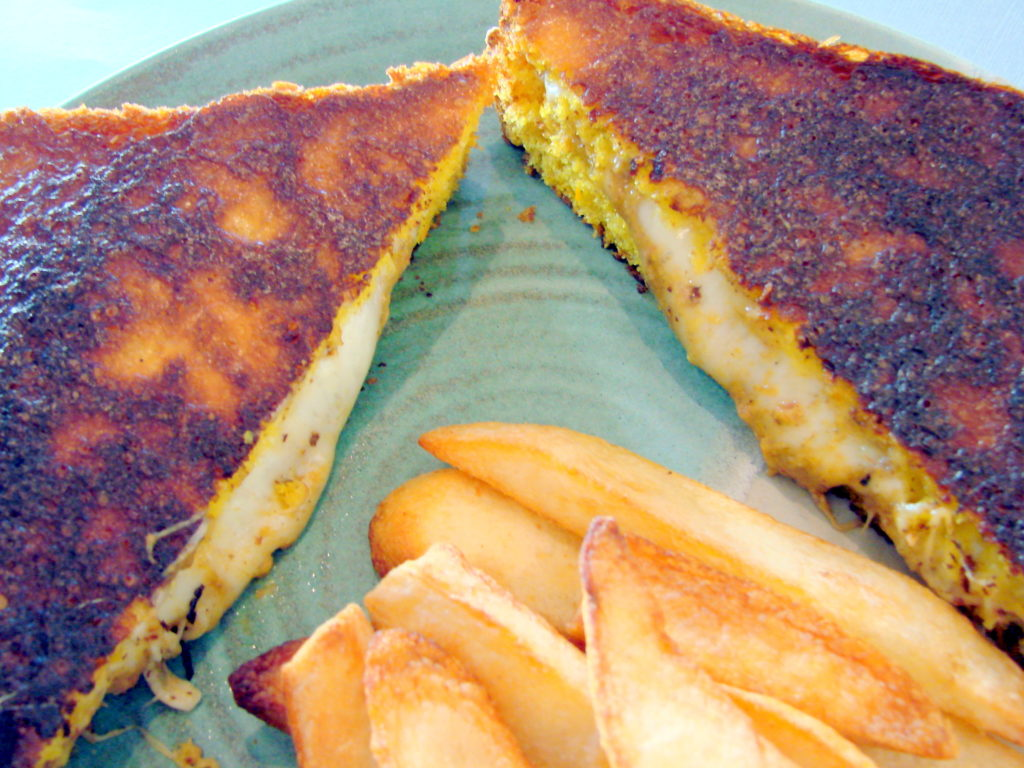 Three kinds of cheeses and a tasty puree brings this sandwich to a high level.