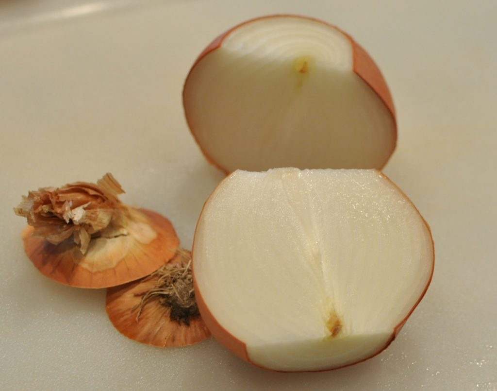After you cut it in half, it is really easy to peel the skin layer off each half of the onion.