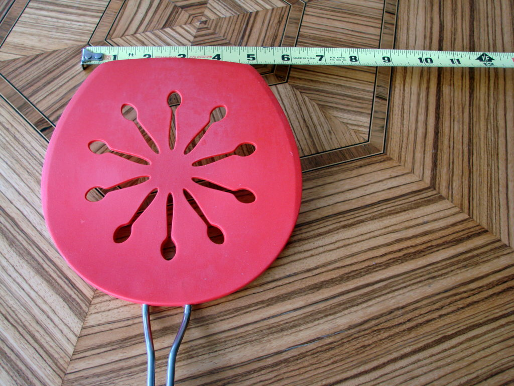 This is the largest spatula I could find. Works well.